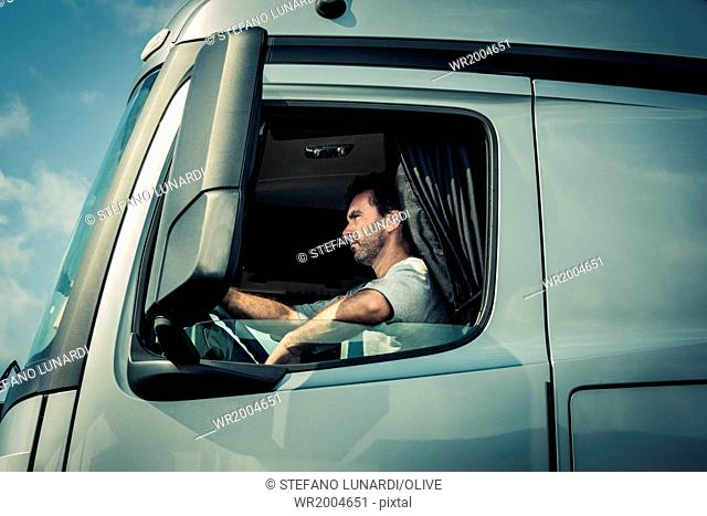 Truck driver with tractor trailor truck