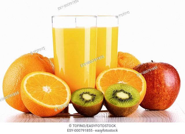 Glasses of orange juice and fruits isolated on white