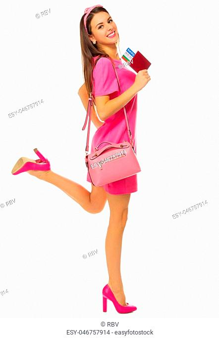 Young traveling girl in pink dress isolated