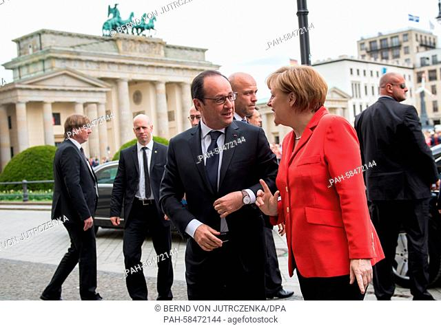 German Chancellor Angela Merkel and French President Francois Hollande arrive to the 6th Petersberg Climate Dialogue inBerlin,Germany, 19 May 2015
