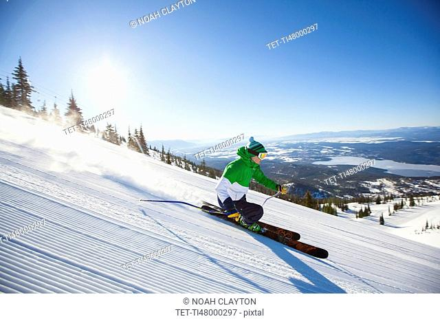 Mature man on ski slope at sunlight