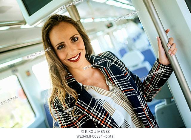 Portrait of smiling woman in a train