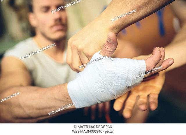 Boxer's hand is being bandaged