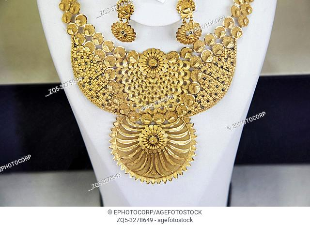 Gold necklace and earrings for sale at a shop, Dubai, UAE