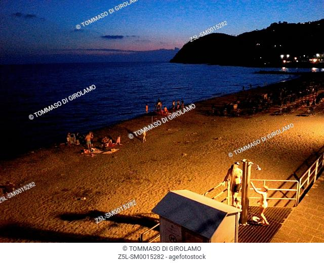 Italy, Liguria, Levanto, Beach by night
