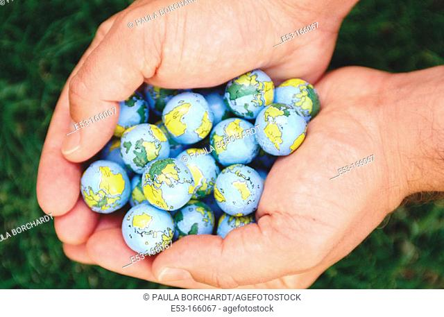 Hands holding 'Earth balls'