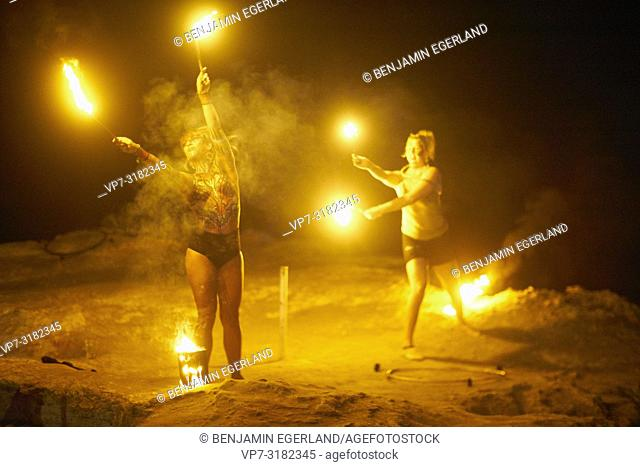 fire dancers performing at Tribal Beach Party at Starbeach Chersonissos, Crete, Greece