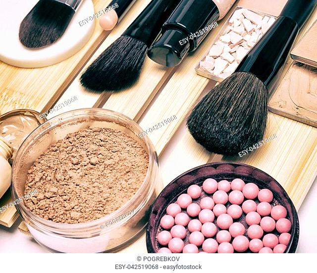Makeup products and accessories to hide pigmentary imperfections, even out skin tone and complexion: concealer, foundation, powders, blush, make up brushes