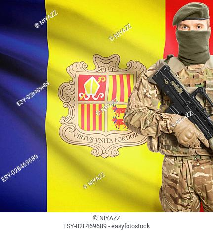 Soldier holding machine gun with national flag on background - Andorra