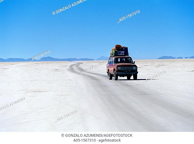 Driving car on the salt lake Salar de Uyuni, Altiplano, Bolivia, South America