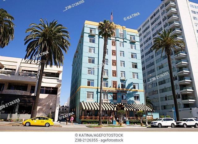 Historic Georgian Hotel and pedestrians alongside Ocean Avenue in Santa Monica, City of Los Angeles, California, USA