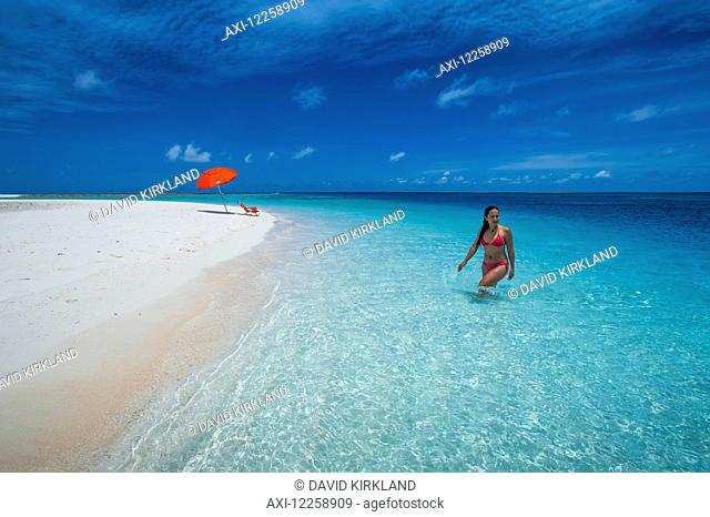 A woman wading in the pristine waters; Marshall Islands