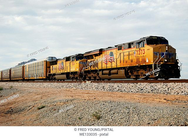 Picacho, AZ, USA - October 18, 2014: An approaching diesel locomotive pulling boxcars