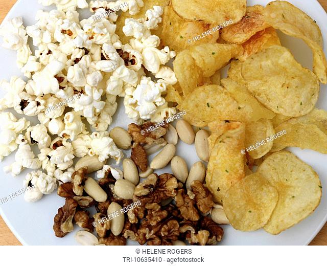Crisps, Popcorn And Nuts On A Plate
