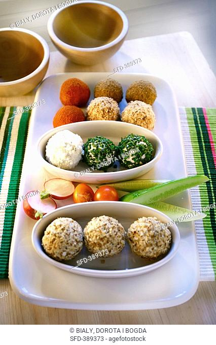 Soft cheese balls coated in nuts, herbs and spices