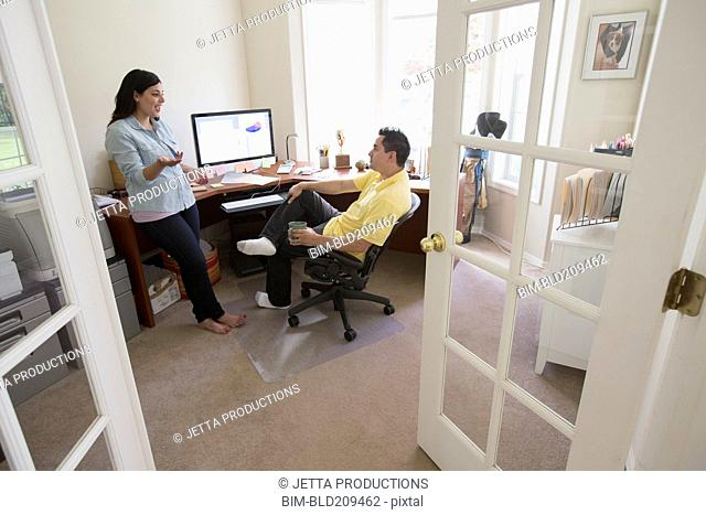 Couple talking in home office