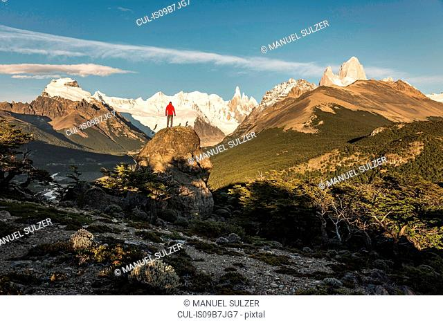 Male hiker looking out Cerro Torre and Fitz Roy mountain range in Los Glaciares National Park, Patagonia, Argentina