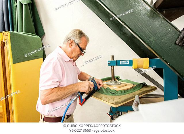 Tilburg, Netherlands. The 72 year old 'Boy' still works as an independent upholsterer in his own workshop, down town Tilburg