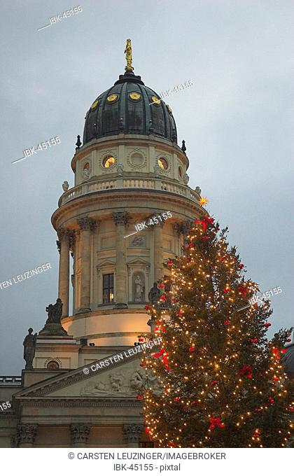 Illuminated Christmas tree at Weihnachtszauber Christmas fair in front of Deutscher Dom at Gendarmenmarkt Berlin Germany