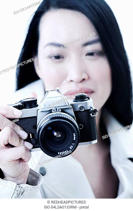 Woman taking pictures with camera
