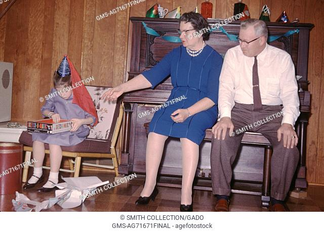 Vernacular snapshot image of daughter, parents and party, 1963