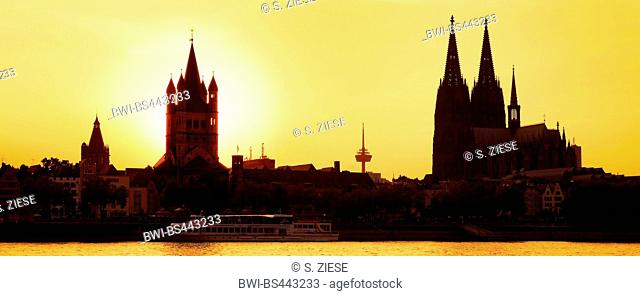 silhouettes of Great St. Martin Church and Cologne Cathedral at sunset, Germany, North Rhine-Westphalia, Cologne