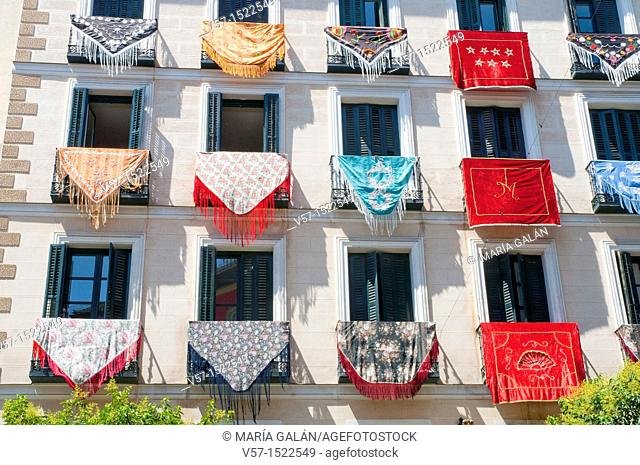 Facade of house with Mantones de Manila, La Paloma festivals. Madrid, Spain