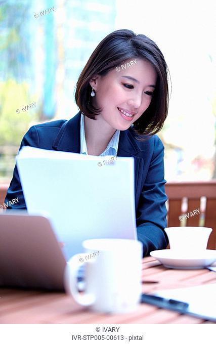 Businesswoman Working At Outdoor Café