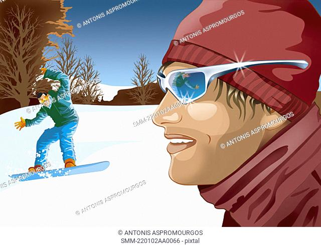 Man in foreground with man in background trying to ski