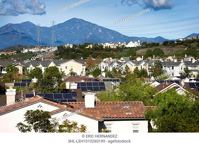 Rooftop view of community with solar panels