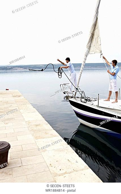 Croatia, Sailboat entering port, docking maneuver