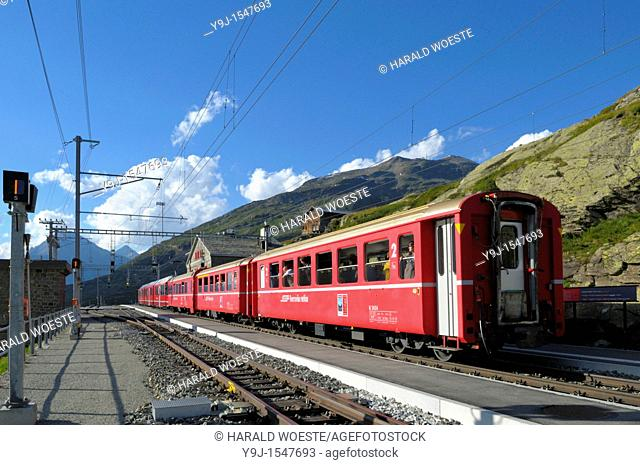 Train of Rhätische Bahn at Ospizio Bernina railway station on the Berninapass  Switzerland, Western Europe, Graubünden, Bernina