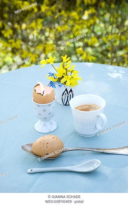 Breakfast table with Eatser decoration in garden