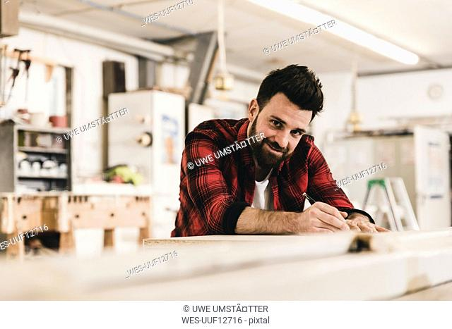 Portrait of smiling man in workshop
