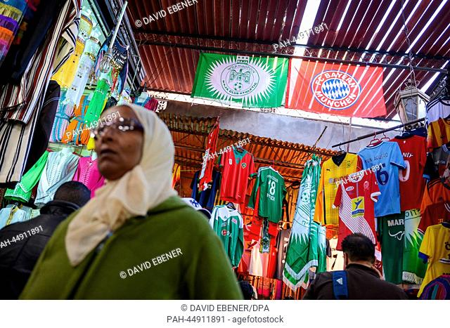 FCBayern Munich and Raja Casablanca fan articles hang in a souk in Marrakesh, Morocco, 19December 2013. FCBayern Munich will play Raja Casablanca in the...