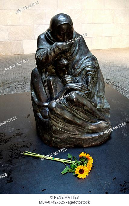 Germany, Berlin, Mitte district, Neue Wache Memorial who shelters the memorial with the victims of Fascism and militarism with an enlarging of the statue of...