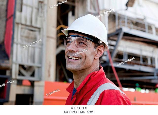 Happy engineer on oil rig