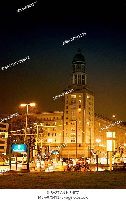 A tower of the Frankfurt Tor at night in Berlin Friedrichshain with the adjacent subway station