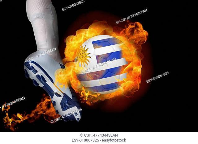 Football player kicking flaming uruguay ball