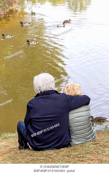 Couple by a lake
