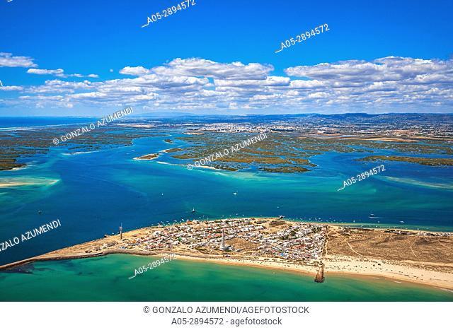 In the foreground Farol island. In the background Ria Formosa, natural park and Faro. Faro district. Algarve. Portugal