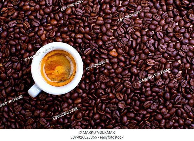 espresso cup with a lot of coffee beans