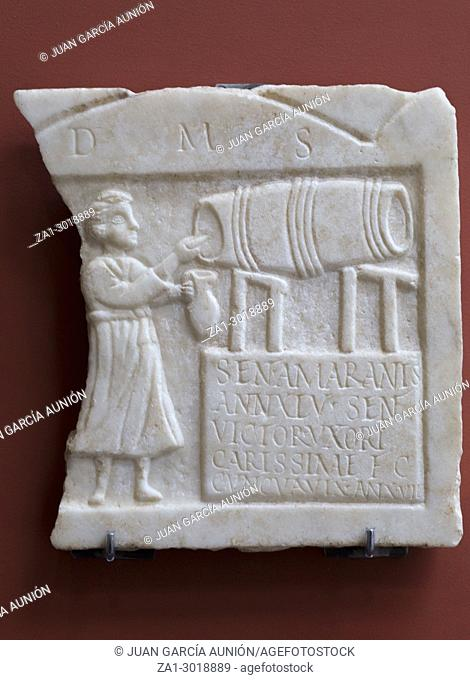 Stela of Sentia Amarantis. Tombstone showing a tavern keeper tapping wine from a barrel at National Museum of Roman Art in Merida, Spain