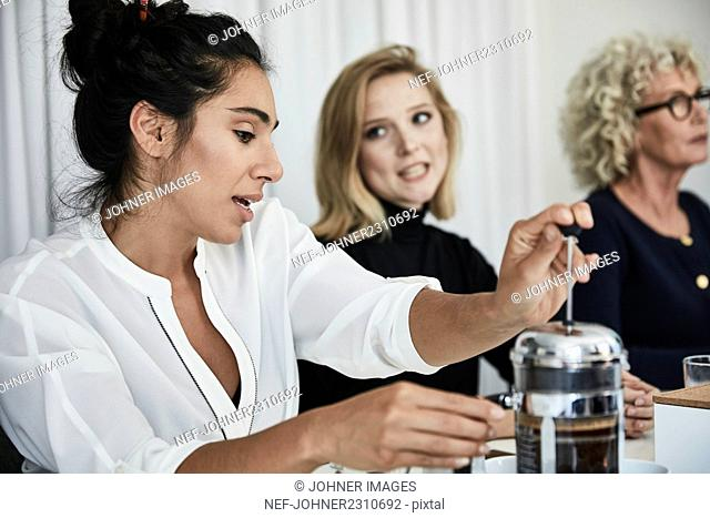 Woman making coffee in French press