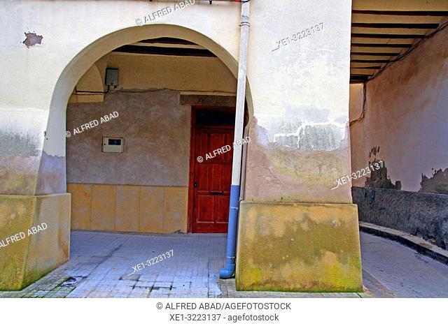 sidewalk with arcade and street, Linyola, Lleida, Catalonia, Spain