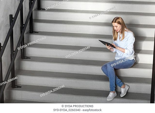 woman or student with tablet pc sitting on stairs