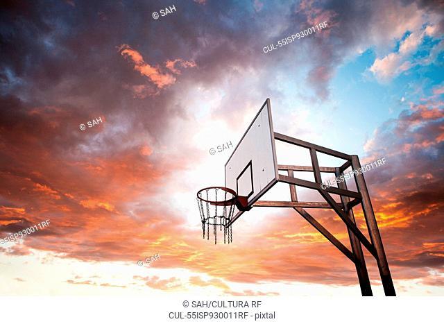 Basketball hoop and dramatic sky