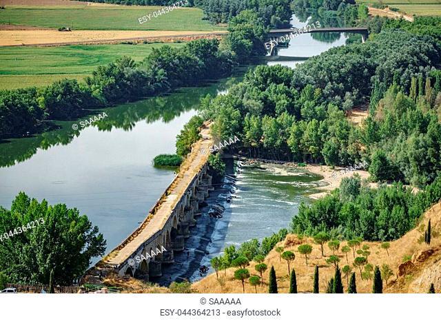 Long shot of Tordesillas antique bridge over Duero river