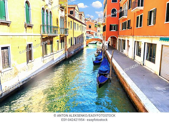 Quiet canal of Venice with gondolas and no tourists