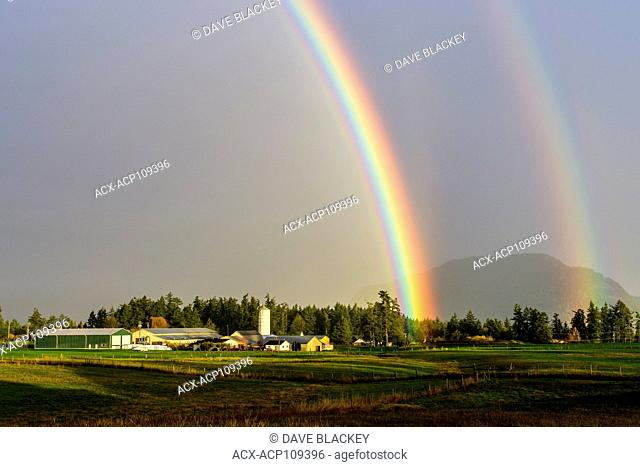 A double rainbow over a farm in Cowichan Bay, British Columbia